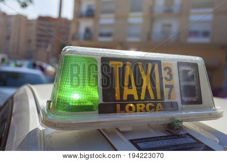 Lorca Spain - May 29 2017: Free taxi with a green light at the central station of Lorca province of Murcia Spain