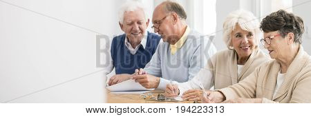 Group of happy retired people chatting at third age university