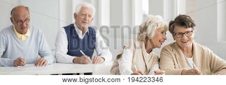 Seniors taking notes and enjoying university of the third age classes