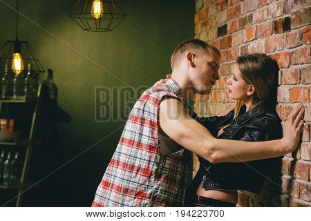 Man hitting on a girl he just met in bar