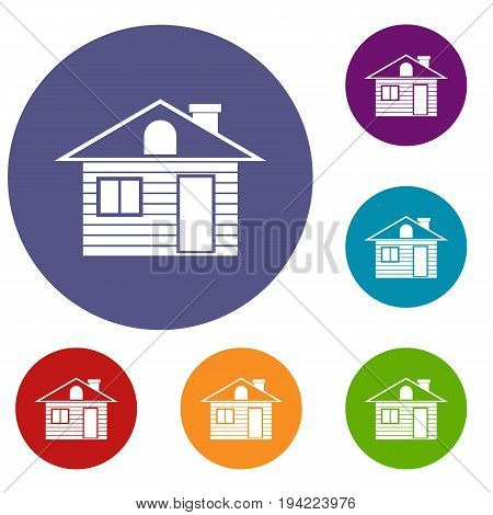 Wooden log house icons set in flat circle reb, blue and green color for web