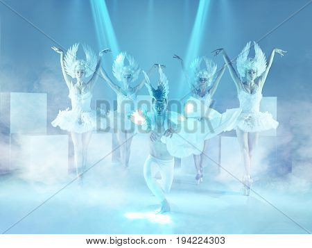 The studio shot of group of modern dancers in the roles of a white swans on blue background