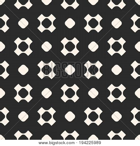 Vector seamless pattern. Simple geometric texture with rounded shapes, circles, perforated crosses in staggered array. Dark abstract minimalist background. Design element for prints, covers, digital.