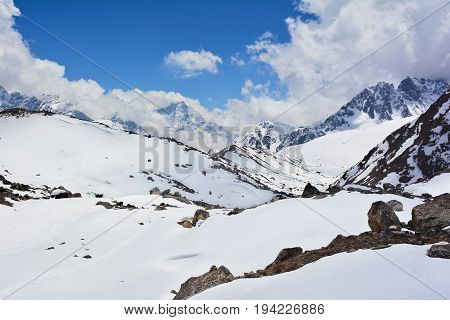 View to the Gokyo valley and Himalayan mountains covered with snow on the way to Cho-Oyu base camp Nepal