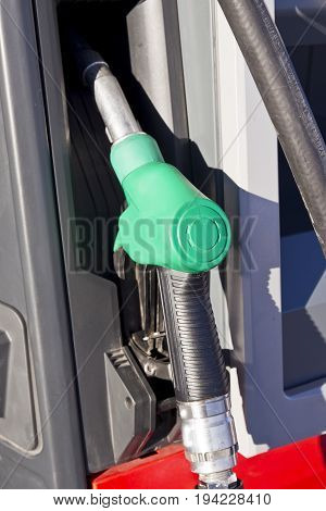green handle petrol pump depicting an unleaded fuel or gasoline