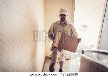 Messenger delivering a parcel to your door
