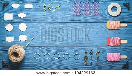 Top View Of Wooden Table With Tools For Scrapbooking And Copy Space
