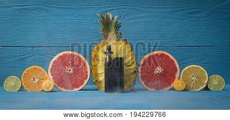 Black Vaporizer Surrounded By Citrus