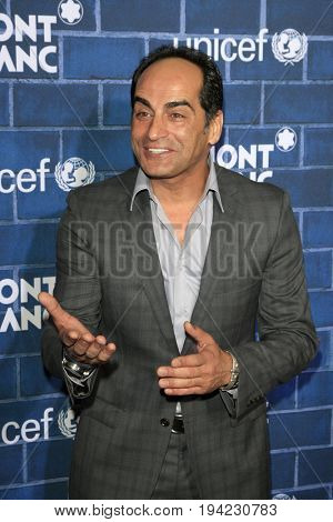 LOS ANGELES - FEB 23:  Navid Negahban at the Pre-Oscar charity brunch by Montblanc & UNICEF at Hotel Bel-Air on February 23, 2013 in Los Angeles, CA