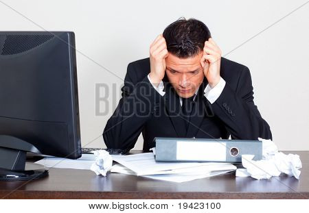 Worried businessman with paperwork stressful businesslife