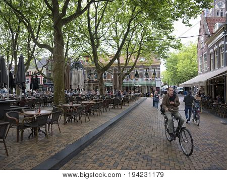 delft netherlands 30 june 2017: people on outdoor cafe in center of old dutch town delft in the netherlands