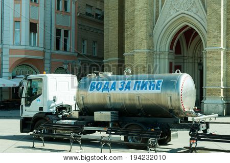 Cistern truck with fresh drinking water tank in the city for hot summer days. Translation - drinking water. June - 29. 2017. Novi Sad, Serbia. Editorial image.