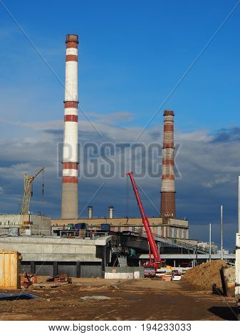 Moscow Russia June 22 2017: Construction of a flyover in Moscow against the backdrop of an enterprise for the production of electricity. Russia.