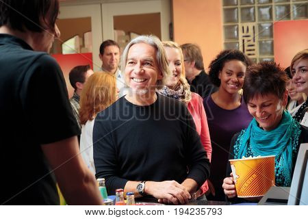 people at the cinema, standing in line to buy drinks and popcorn