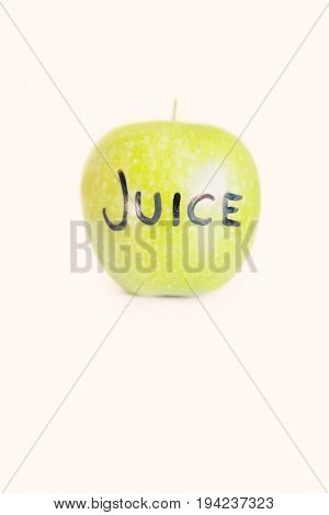 Close-up of text on a granny smith apple over white background