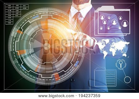 Man's hand pointing at abstract digital business chart and graph projection. Technology and touchscreen concept. Double exposure