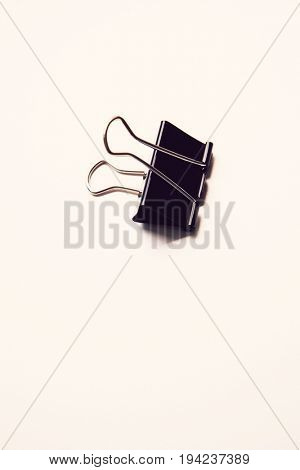 Single binder clip over white background