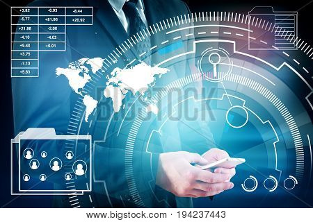 Businessman using smartphone with abstract blue business hologram on dark background. Technology concept. Double exposure