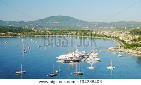 Aerial view on the town Kerkira and white boats in the Garitsa Bay on the Island Corfu Greece.