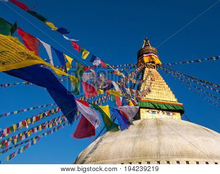 Kathmandu, Nepal: Boudhanath, a huge Buddhist stupa with blue eyes and a sacred prayer flags.