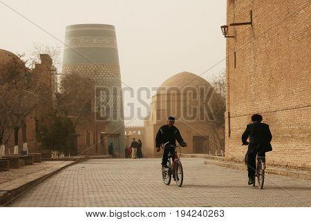 Khiva Uzbekistan - March 08 2009: A typical street in Khiva Uzbekistan. Sandstorm