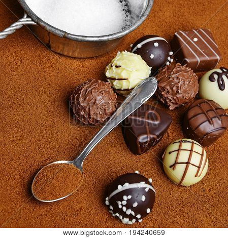 pralines and a chocolate background close up