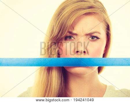 Attractive Blonde Woman Covering Mouth With Tape.
