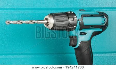 cordless drill on the background of the case closeup