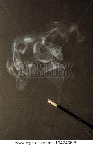Burning Incense Sticks With Smoke On Dark Background