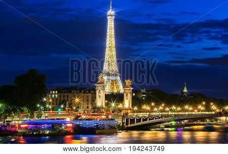 PARIS - JUNE 30, 2017 : Eiffel Tower Light Performance Show in Dusk on June 30, 2017. The Eiffel tower is the most visited monument of France located on bank of Seine river.