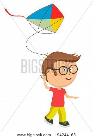 Cute little nerd boy with glasses playing with colorful kite over white background