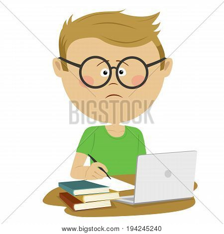 Unhappy nerd boy pupil with glasses sitting at the desk with stack of books and a loptop
