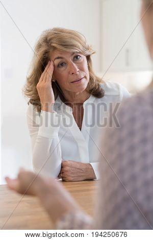 Mature Woman Discussing Problems With Female Counselor