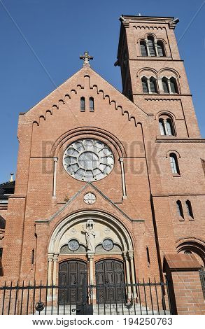 The facade of a neo-Gothic Catholic church in Poznan