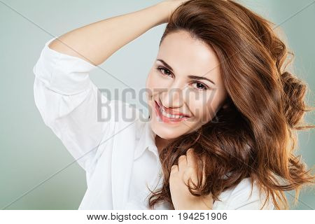 Cute Smiling Woman with Red Curly Hair. Happy Redhead Girl