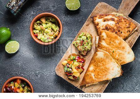 Grilled Quesadillas (tortillas) With Salsa, Guacamole. Dark Background, Top View.