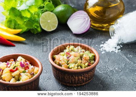 Salsa And Guacamole Dips With Ingredients. Mexican Cuisine Concept