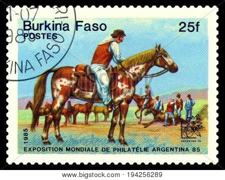 STAVROPOL RUSSIA - July 07 2017: stamp printed by Burkina Faso shows Shepherds of horses Exhibition of philately. Argentina 1985 circa 1985