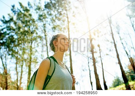 Smiling Young Woman Hiking In A Forest In Summer