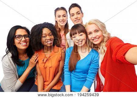diversity, race, ethnicity and people concept - international group of happy smiling different women over white hugging and taking selfie