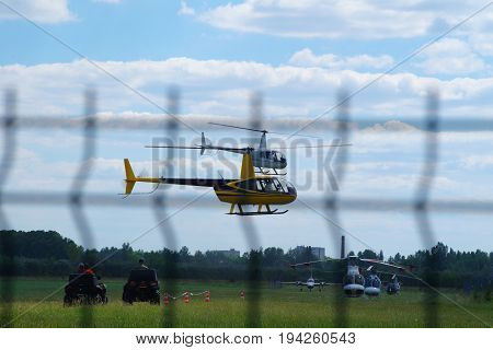 Ultra light helicopters flying synchronously over the flight