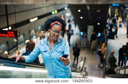 Young Woman Listening To Music During Her Daily Commute