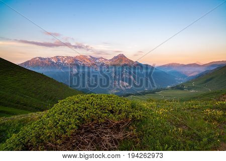 Colorful Sunlight On The Majestic Mountain Peaks And Ridges Of The Italian Alps. Fog And Mist Coveri