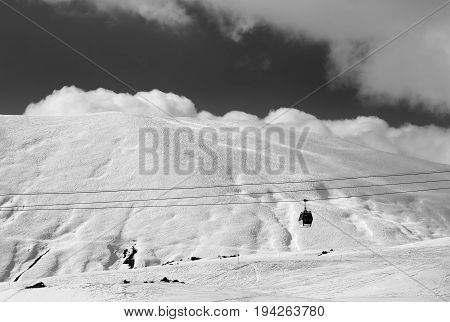 Black And White View Of Gondola Lift And Off-piste Slope At Evening