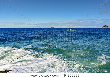 Fishing boat sailing in the waters of the Rio de Janeiro sea