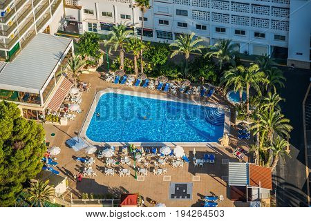 Benidorm Spain - Septiembre 11 2016: view of swimming pool and colorful hotel buildings on sunny summer day Benidorm Spain