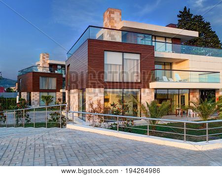 SOCHI, RUSSIA, SEP, 10, 2015: Evening view on Adler seaside loft style brown luxury villas of wood glass natural stones at stone beach. Modern resort architecture. Best Sochi holidays vacation tours