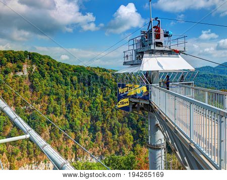 SOCHI, RUSSIA, SEP, 05, 2015: SKYPARK MegaTroll tower start point. 700 m of high speed free fall sliding for people tourists for fun. Sochi sightseeing holiday vacation best tours travel sightseeing