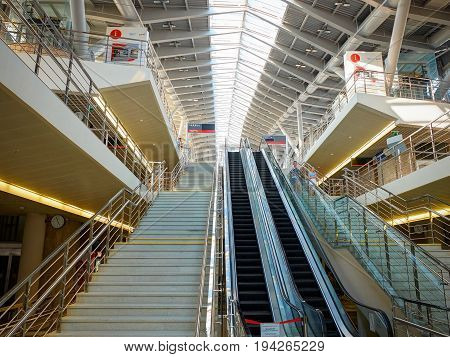ADLER, RUSSIA, SEP, 07, 2015: Olympic Park railway station interior architecture. Escalators and stairs staircases ways to platforms, metal glass roof. Russian rail roads RZD. Railway station interior
