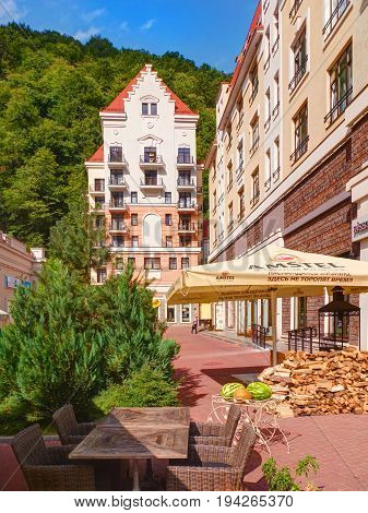 SOCHI, RUSSIA, SEP, 10, 2015: View on Rosa Khutor colorful modern buildings, restaurants, outdoor coffee bar furniture. Olympic village Sochi 2014. Best famous Sochi holidays vacation bike ski tours